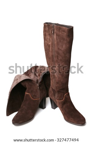 Suede boots on white background - stock photo