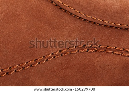 Suede surface of a boot with stitches - stock photo