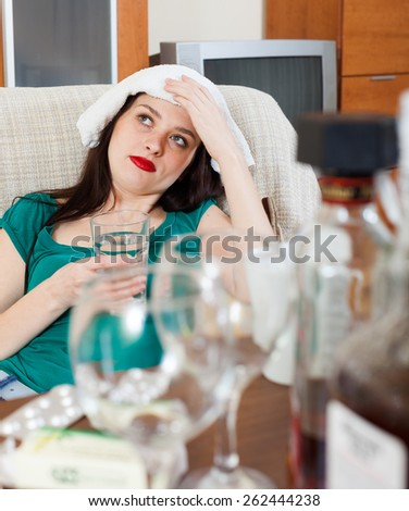 Suffering girl with glass of water  - stock photo