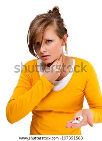 Suffering woman holding pills isolated on white background - stock photo