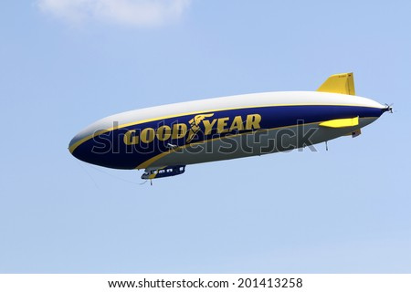 SUFFIELD, OHIO, USA - June 28, 2014: The Goodyear Zeppelin NT flying at the Airship Base in Suffield, Ohio. - stock photo