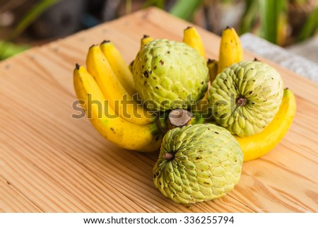 Sugar Apple (custard apple, Annona, sweetsop) and Fresh bananas on wooden background