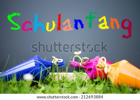 Sugar bags and chalkboard with the german words Back to School / starting school - stock photo