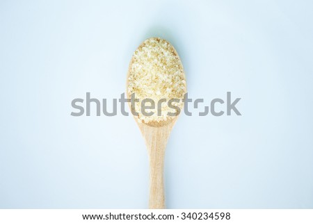 sugar cane brown on spoon and background - stock photo