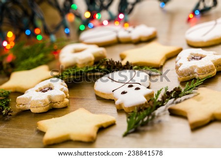 Sugar cookies in shape of snowman, stars, and christmas tree on wood table. - stock photo