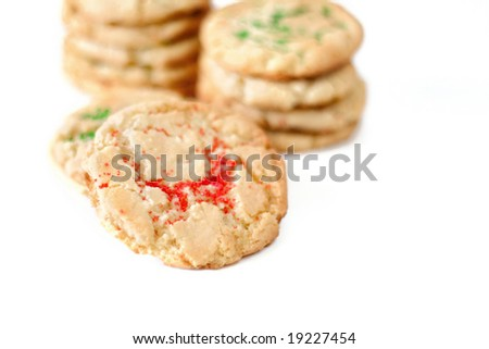 Sugar cookies with red and green sprinkles isolated on white.  Used a shallow DOF and selective focus. - stock photo