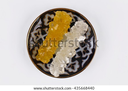 Sugar crystal on white - stock photo