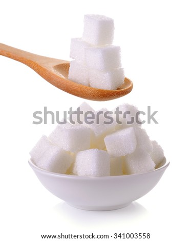 sugar cube in the spoon and bowl on white background - stock photo