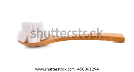 Sugar cube in wooden spoon isolated on white background