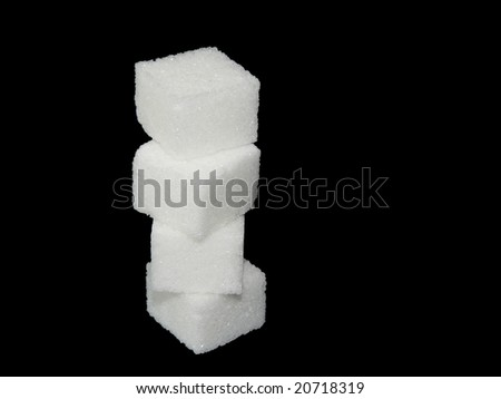 Sugar cube on black background - stock photo