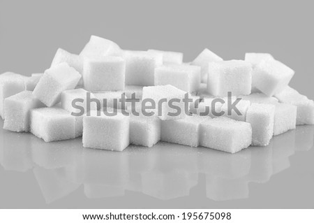 Sugar cubes isolated on gray  background