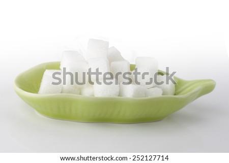 sugar cubes isolated on white background - stock photo