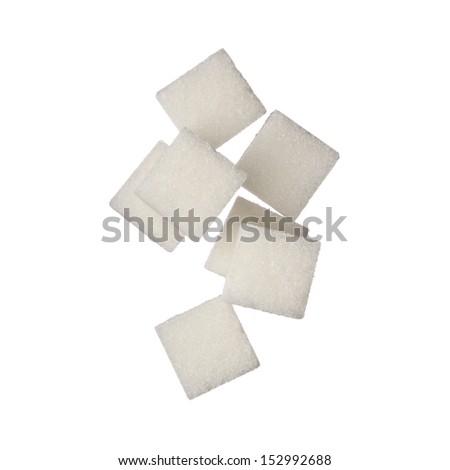 Sugar cubes on white background, close up - stock photo