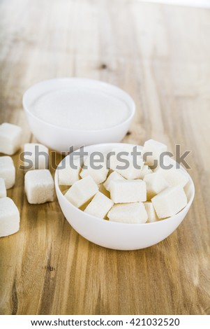 Sugar in a white bowl on the table