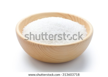 Sugar in a wooden bowl on white background - stock photo