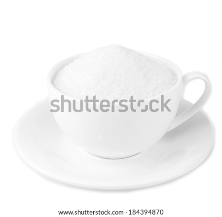 Sugar in cup isolated on white - stock photo