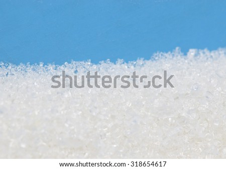 sugar on a blue background