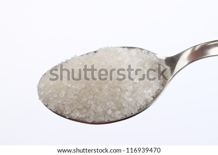 sugar on a teaspoon isolated on white background - stock photo