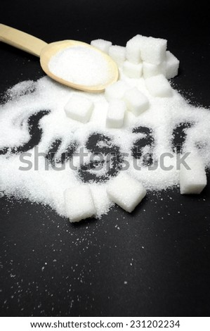 Sugar on black background close up - stock photo