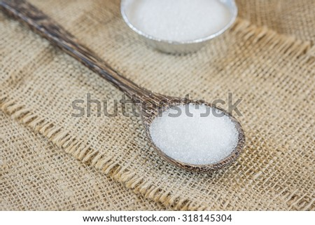 Sugar on the wooden spoon - stock photo