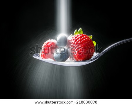 Sugar over strawberry, blueberry, raspberry - stock photo