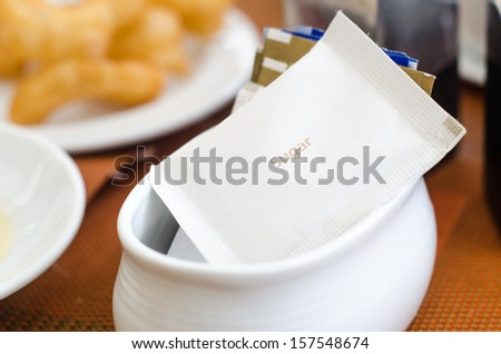 Sugar packet on table - stock photo