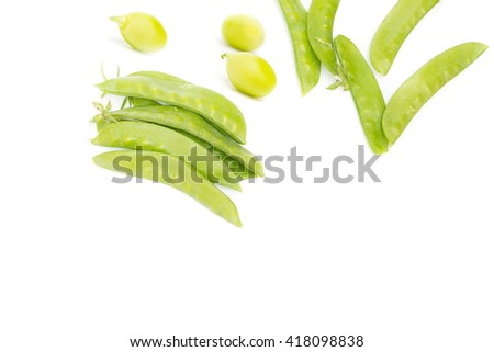 Sugar Pea,fresh green peas, Sweet peas, Garden Pea, snow peas, seed peas, Pea pale Isolated on white background, and soft-focus background. select focus front nuts. - stock photo