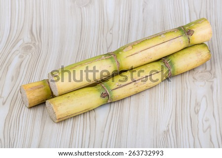 Sugar reed sticks on the wooden background