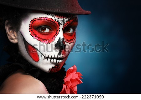 Sugar skull girl in hat, studio shot  - stock photo