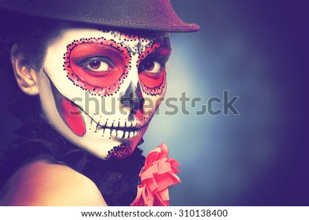 Sugar skull girl in hat, studio shot Fashion retro toning. - stock photo