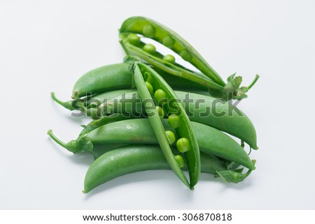 Sugar snap peas isolated on white background