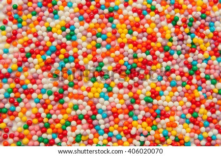 Sugar sprinkle dots, decoration for cake and bekery, a lot of sprinkles as a background - stock photo