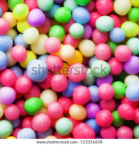 Sugar sprinkle dots or sugar balls, decoration for confectionery. High  magnification macro. - stock photo