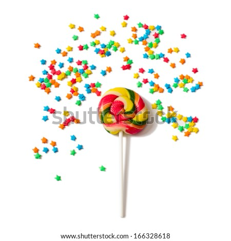Sugar sprinkles on top of icing birthday cake. Colored glaze decoration for the cake - stock photo