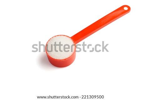 Sugar stack in a measuring spoon - stock photo