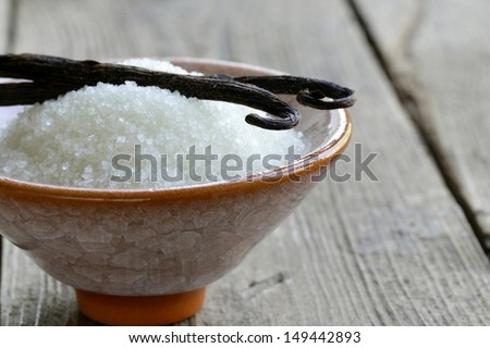 sugar with natural vanilla pods in a cup