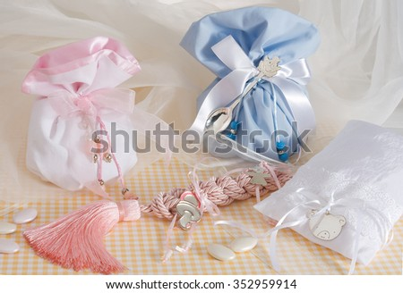 sugared almonds in the traditional  christian baptism pouches,pink for the girl and blue for the boy - stock photo