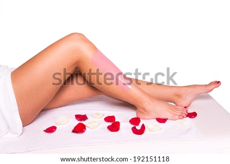 Sugaring: epilation with liquate sugar at legs. - stock photo
