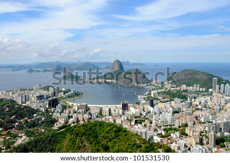 Sugarloaf Mountain in Rio de Janeiro, Brazil. Guanabara bay, boats and the busy city. - stock photo