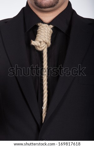 Suicidal businessman with noose around his neck with black suit - stock photo