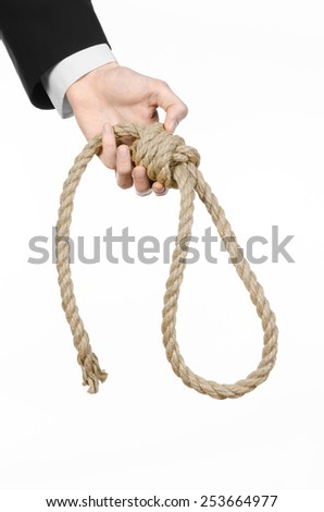 Suicide and business topic: Hand of a businessman in a black jacket holding a loop of rope for hanging on white isolated background