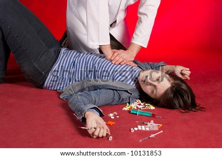 Suicide. Emergency actions - cardiac massage. See portfolio for more... - stock photo