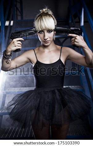 Suicide. Young blonde woman with black dress holding a gun. - stock photo