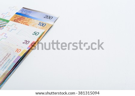 Suisse Francs Bills on White Table with Copy Space