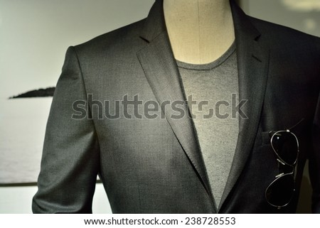 Suit, a black man with glasses cool.