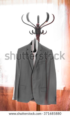 Suit and tie on hanger  - stock photo