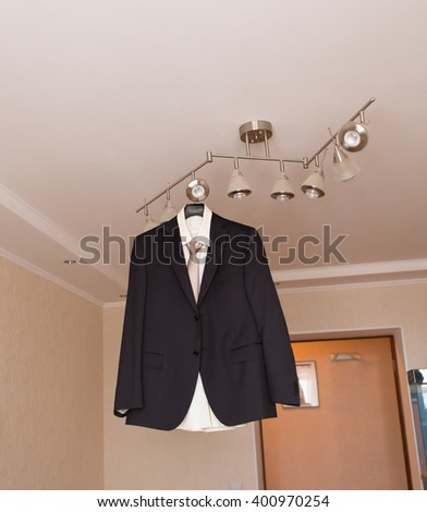 suit hanging on hangers - stock photo