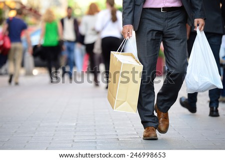 Suit with shopping bags on shopping street
