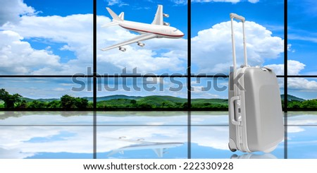 suitcase and airplane taking off at  airport with tropical forest mountains with blue sky