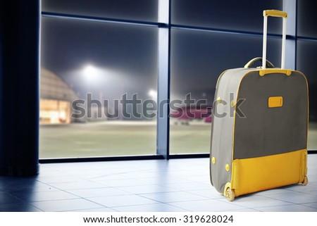 suitcase and floor  - stock photo